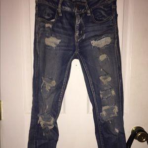 Dark wash distressed blue jeans